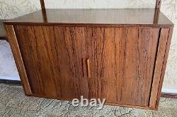 1960s Danish rosewood wall mounted unit. Designed by Kai Kristiansen for FM