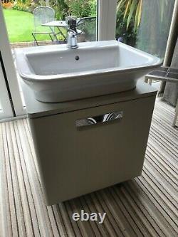 Roca wall mounted basin & vanity unit with Bristan mono tap matching bath tap